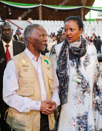 Stock Picture of Former President of South Africa Thabo Mbeki (L) who is heading the African Union election  observer mission to Kenya, is received upon his arrival by Kenya's Foreign Affairs Minister Amina Mohamed (R) before Kenya's election commission Independent Electoral and Boundaries Commission (IEBC), chairman Wafula Chebukati made his announcement where he declared President Uhuru Kenyatta and his Deputy President William Ruto as the winners of the repeat presidential poll conducted on 26 0ctober at the Bomas of Kenya in Nairobi, Kenya, 30 Ocotber 2017. Kenyatta said he may engage in political dialogue with opposition leader Raila Odinga of the National Super Alliance (NASA) after the election processes are settled, the local media reported.