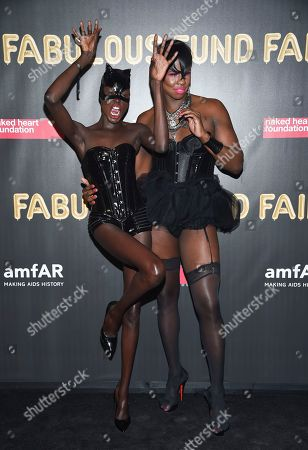 Ajak Deng, left, and guest attend the Fabulous Fund Fair, hosted by the Naked Heart Foundation and amfAR, at Skylight Clarkson North, in New York