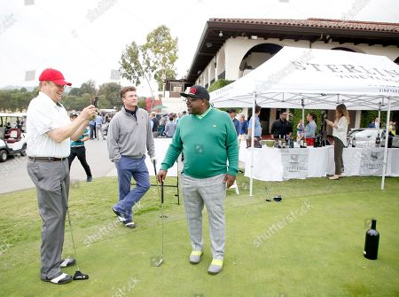 Peter Mackenzie, Pat Finn, Cedric the Entertainer. Peter Mackenzie, from left, Pat Finn, and Cedric the Entertainer on the putting green at the 18th Annual Emmys Golf Classic presented by the Television Academy Foundation at the Wilshire Country Club, in Los Angeles, Calif