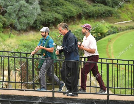 Joe Mantegna, Adam Rodriguez. Joe Mantegna, left, and Adam Rodriguez at the 18th Annual Emmys Golf Classic presented by the Television Academy Foundation at the Wilshire Country Club, in Los Angeles, Calif