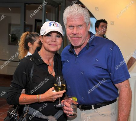 Stock Photo of Ron Perlman, Paula Trickey. Paula Trickey, left, and Ron Perlman at the 18th Annual Emmys Golf Classic presented by the Television Academy Foundation at the Wilshire Country Club, in Los Angeles, Calif
