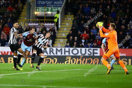 James Tarkowski of Burnley sees a headed attempt on goal saved by Rob Elliot of Newcastle United