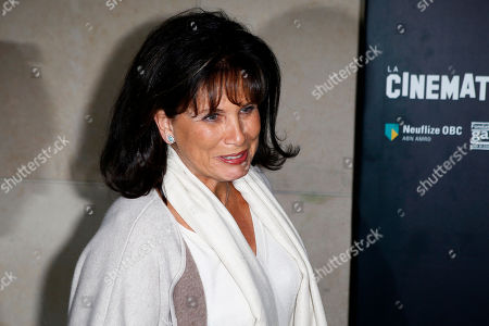 "Stock Image of French journalist Anne Sinclair arrives at a photocall prior to the screening of Polanski's movie ""Based on a true story"" in Paris, France, . France's famed film institute La Cinematheque Francaise says it will go ahead with a retrospective of works by director Roman Polanski despite opposition by feminist groups, in regard to the Polish-born director who in the 1970s pleaded guilty to having sex in the U.S. with a 13-year-old girl whom he plied with champagne and Quaaludes"