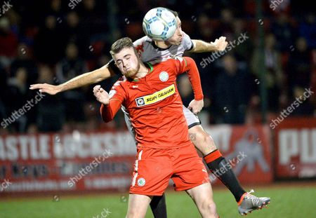 Cliftonville vs Crusaders. Cliftonvilles Rory Donnelly with Crusaders Sean Ward