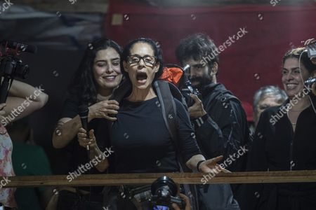 Stock Photo of Brazilian actresses Sonia Braga (C-R) and Leticia Sabatella (C-L) participate in a protest to support the occupation land by over six thousand families in Sao Bernardo do Campo in Sao Paulo, Brazil, 30 October 2017. 