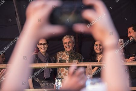 Brazilian singer Caetano Veloso (C) accompanied by the Brazilian actresses Sonia Braga (L) and Leticia Sabatella (R) participate in a protest to support the occupation of a private land by over six thousand families in Sao Bernardo do Campo in Sao Paulo, Brazil, 30 October 2017. This settlement was established by 6000 families since 01 September 2017, with the help of the Roofless Workers' Movement. The Roofless Workers' Movement (sometimes translated as the Homeless Workers? Movement)  as a way to demand that the government address the homeless situation, stage squatter settlements on government land and abandoned buildings.