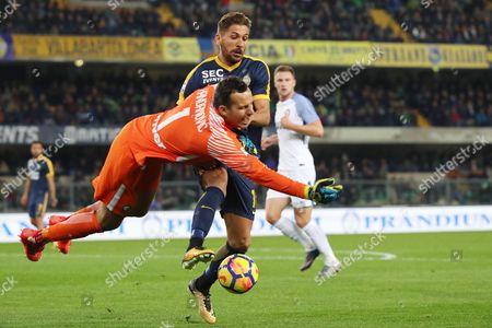 Inter's goalkeeper Samir Handanovic (L) fouls Verona's Alessio Cerci during the Italian Serie A soccer match between Hellas Verona FC and Inter FC at Bentegodi stadium in Verona, Italy, 30 October 2017.