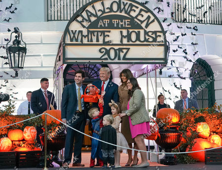 Donald Trump, Melania Trump, Sarah Huckabee Sanders, Bryan Sanders, Scarlett Sanders, Huck Sanders, George Sanders. President Donald Trump and first lady Melania Trump pose for photographs with White House press secretary Sarah Huckabee Sanders, far right, her husband Bryan Sanders, far left, and Sanders' children from l-r., Huck Sanders, George Sanders and Scarlett Sanders, during a event celebrating Halloween on the South Lawn of the White House in Washington
