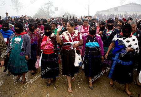Maria de Jesus Patricio, presidential candidate for the National Indigenous Congress, campaigns with an escort of masked indigenous women in the Zapatista stronghold of Oventic in the southern state of Chiapas, Mexico. Even though Patricio's backers say their candidate is handicapped by electoral officials using a smartphone app to record the signatures necessary to get candidates on the ballot, she came in second place after the wife of former president Felipe Calderon