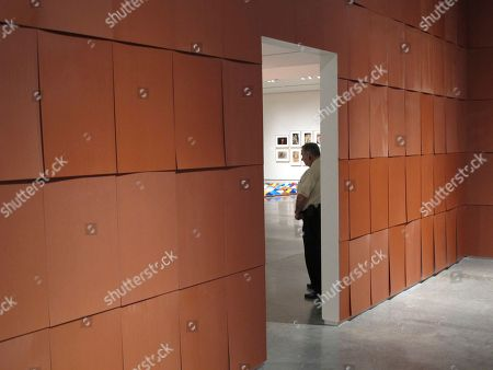 A guard stands outside the ''Chocolate Room'' by American artist Ed Ruscha on display in the exhibit ''Unsettled'' at the Nevada Museum of Art in Reno, Nev. The room made from sweet-smelling chocolate shingles is the fifth version of Ruscha's work since it debuted at the 1970 Venice Biennale in Italy