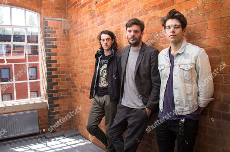 Stock Picture of British band members of the Klaxons, from left to right, Simon Taylor-Davis, Jamie Reynolds and James Righton, pose for photographs following an interview with the Associated Press at their office in Camden Lock, north London, ahead of the release of their third album, Love Frequency