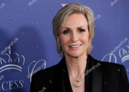 """Actress Jane Lynch poses in Beverly Hills, Calif. """"Fox's Cause for Paws: An All-Star Dog Spectacular"""" is set for Thanksgiving and aims to find 35 dogs on set and thousands of others around the country a home by Black Friday. Hosted by Glee actress Jane Lynch and Hillary Swank, the program airing 8-10 p.m. crams in dog stories, viral videos, dog awards, musical tributes, a fundraiser, contests and glitterati galore"""