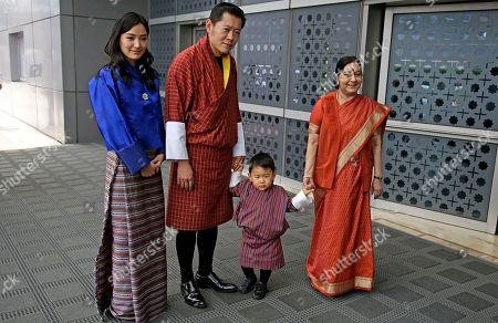 Sushma Swaraj, Jigme Khesar Namgyal Wangchuck, Jetsun Pema, Jigme Namgyel Wangchuck. Indian External Affairs Minister Sushma Swaraj, right, poses with Bhutan's King Jigme Khesar Namgyal Wangchuck, second left, Queen Jetsun Pema, left and their son prince Jigme Namgyel Wangchuck after receiving them at the airport in New Delhi, India, . The Bhutan royals arrived Tuesday on a four-days visit to India