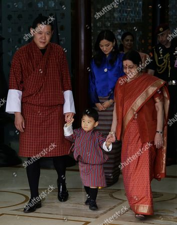 Sushma Swaraj, Jigme Khesar Namgyal Wangchuck, Jetsun Pema, Jigme Namgyel Wangchuck. Indian External Affairs Minister Sushma Swaraj, right, receives Bhutan's King Jigme Khesar Namgyal Wangchuck, left, Queen Jetsun Pema, behind and their son prince Jigme Namgyel Wangchuck at the airport in New Delhi, India, . The Bhutan royals arrived Tuesday on a four-days visit to India
