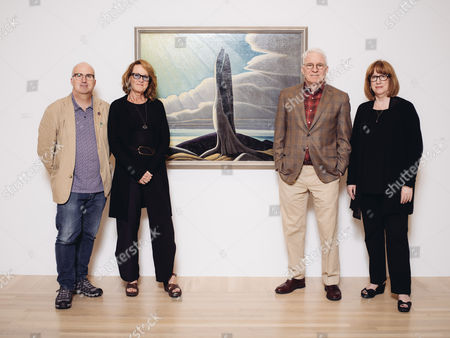 "In this Wed., Oct. 7, 2015, photo, curator and actor-comedian, Steve Martin, second from right, co-curator Andrew Hunter, left, Ann Philbin, second from left, Director of The Hammer Museum, and co-curator Cynthia Burlingham pose in a gallery for the exhibition, ""The Idea of North: The Paintings of Lawren Harris,"" at The Hammer Museum in in Los Angeles. The show, which travels to Boston's Museum of Fine Arts and Canada's Art Gallery of Ontario next year, opens"
