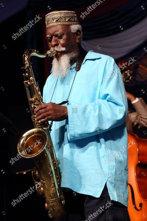 Pharoah Sanders performs at the 2014 New Orleans Jazz & Heritage Festival in New Orleans. Sanders, along with fellow saxophonist Archie Shepp and vibraphonist Gary Burton, are the newest recipients of the 2016 Jazz Masters. The awards will be presented on April 4, 2016 at a concert at the Kennedy Center