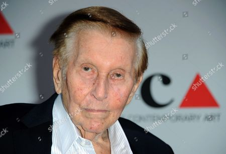 Media mogul Sumner Redstone arrives at the 2013 MOCA Gala celebrating the opening of the Urs Fischer exhibition at MOCA, in Los Angeles. A judge ruled, that Sumner Redstone should give 30 minutes of videotaped, sworn testimony in a case about the ailing media mogul's mental capacity that was filed by Redstone's ex-girlfriend and longtime companion, Manuela Herzer