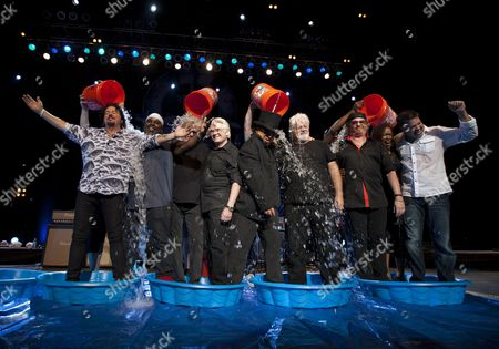 Members of the band Toto (Steve Lukather, Mabvuto Carpenter, Steve Porcaro, David Hungate, David Paich, Joseph Williams, Jenny Douglas, Keith Carlock), along with former Doobie Brother Michael McDonald, accepted the ALS Ice Bucket Challenge onstage during their performance at the Fox Theatre, in Atlanta, Ga