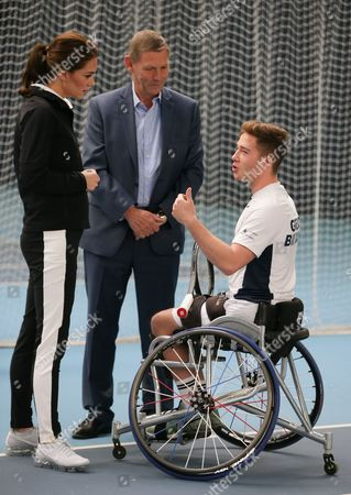 Catherine Duchess of Cambridge (L), talks with President of the LTA, Martin Corrie (C) and British tennis player Alfie Hewett (R) during a visit at the Lawn Tennis Association (LTA) at the National Tennis Centre
