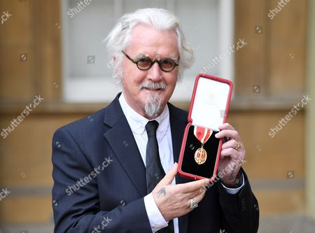 Billy Connolly receives knighthood for his services to entertainment and charity