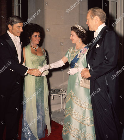 Elizabeth Taylor with her future husband Jack Warner meeting Queen Elizabeth II and President Gerald Ford at the British Embassy reception in Washington, during the State Visit of Queen Elizabeth to America