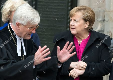 Bishop Heinrich Bedford-Strohm, chair of the Council of the Evangelical Church in Germany (EKD), welcomes German Chancellor Angela Merkel prior the festive service on the occasion the 500th Anniversary of the Reformation in Wittenberg, Germany