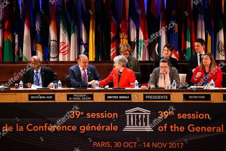 Director-General of the United Nations Educational, Scientific and Cultural Organisation (UNESCO) Irina Bokova, third left, looks at Dominican Ambassador and Permanent Delegate to UNESCO and president of the Executive council Jose Antonio Rodriguez, second left, during the 39th session of the General Conference at the UNESCO headquarters in Paris, France