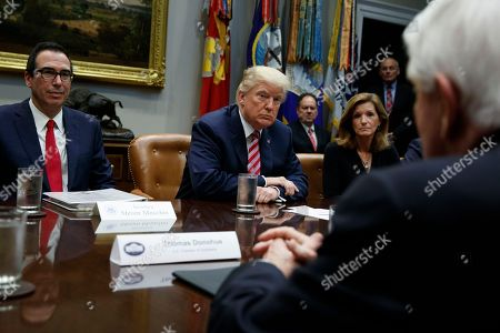 Donald Trump, Steve Mnuchin, Karen Kerrigan, Tom Donahue. President Donald Trump listens during a meeting on tax policy with business leaders in the Roosevelt Room of the White House, in Washington. From left, Treasury Secretary Steve Mnuchin, Trump, Karen Kerrigan, President and CEO, Small Business & Entrepreneurship Council, and Tom Donohue, President and CEO, U.S. Chamber of Commerce, foreground