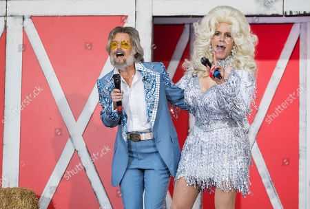"""Stock Picture of Matt Lauer, Savannah Guthrie. Savannah Guthrie, left, and Matt Lauer dress as Kenny Rogers and Dolly Parton during NBC's """"Today"""" show Halloween special at Rockefeller Plaza, in New York"""