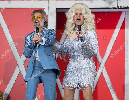 "Matt Lauer, Savannah Guthrie. Savannah Guthrie, left, and Matt Lauer dress as Kenny Rogers and Dolly Parton during NBC's ""Today"" show Halloween special at Rockefeller Plaza, in New York"