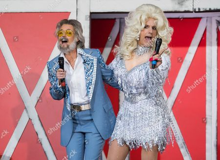 "Stock obrázek na téma Matt Lauer, Savannah Guthrie. Savannah Guthrie, left, and Matt Lauer dress as Kenny Rogers and Dolly Parton during NBC's ""Today"" show Halloween special at Rockefeller Plaza, in New York"