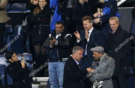 Tony Fernandes applauds his team