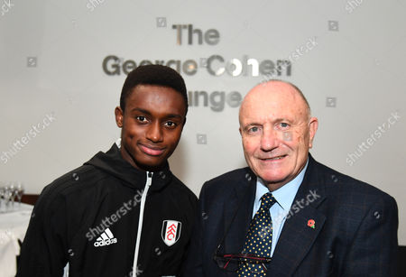 1966 World Cup WInner George Cohen poses for a photo with Under 17 World Cup winner Steven Sessegnon of Fulham