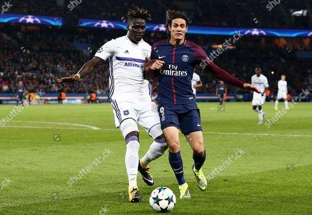 Kara Mbodji of Anderlecht and Edinson Cavani of Paris Saint-Germain.