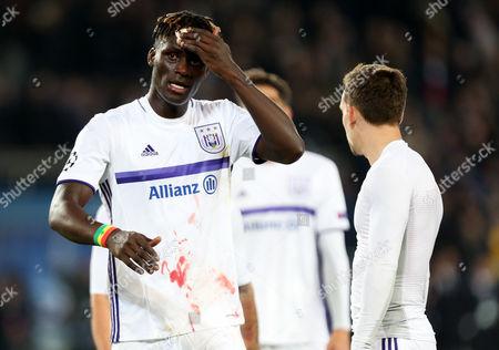 Kara Mbodji of Anderlecht nurses a cut on his head at full time.