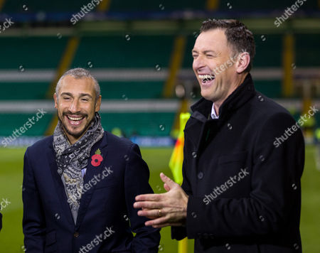 Former Celtic players Henrik Larsson & Chris Sutton share a laugh while they work for ITV Sport before kick off