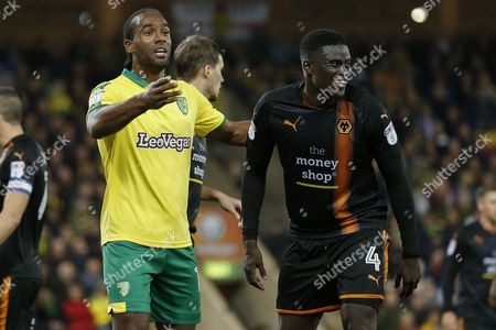 Norwich City forward Cameron Jerome (10) Wolverhampton Wanderers midfielder Alfred N'Diaye (4) during the EFL Sky Bet Championship match between Norwich City and Wolverhampton Wanderers at Carrow Road, Norwich