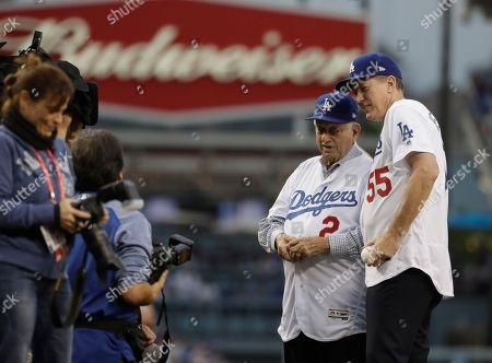 Orel Hershiser and Tommy Lasorda throw out the ceremonial first pitches before Game 6 of baseball's World Series between the Houston Astros and the Los Angeles Dodgers, in Los Angeles