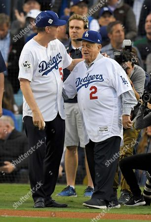 Stock Photo of Orel Hershiser and Tommy Lasorda throw out the ceremonial first pitches before Game 6 of baseball's World Series, in Los Angeles