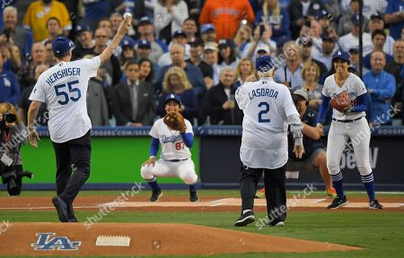 Orel Hershiser and Tommy Lasorda throw out the ceremonial first pitches before Game 6 of baseball's World Series between the Los Angeles Dodgers and the Houston Astros, in Los Angeles