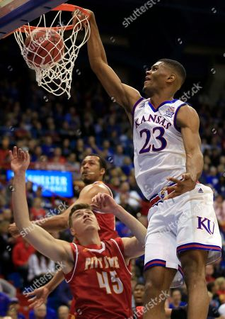 Billy Preston, Jonathan Murray. Kansas forward Billy Preston (23) dunks over Pittsburg State forward Jonathan Murray (45) during the first half of an exhibition NCAA college basketball game in Lawrence, Kan