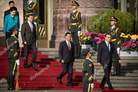 Stock Image of Liu Yandong, Wang Yang, Zhang Gaoli, Li Keqiang. From left, Chinese Vice Premier Liu Yandong, Vice Premier Wang Yang, Vice Premier Zhang Gaoli, and Chinese Premier Li Keqiang arrive for a welcome ceremony for Russian Prime Minister Dmitry Medvedev at the Great Hall of the People in Beijing