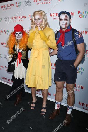 Gus Kenworthy with his mom (L) and boyfriend Matthew Wilkas (R)