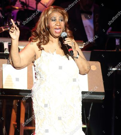Aretha Franklin performs in concert at The Patricia and Arthur Model Performing Arts Center at The Lyric in Baltimore. Franklin, in a statement to the Associated Press on Tuesday, called David Ritz's unauthorized biography, Respect: The Life of Aretha Franklin, a trashy book. Ritz has written a number of biographies, ranging from Etta James to Rick James to Ray Charles. He has won the Ralph Gleason Music Book Award four times, and last year he received the ASCAP Timothy White Award for outstanding musical biography for the Buddy Guy book, When I Left Home.â