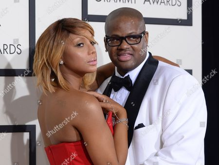 """Stock Picture of Tamar Braxton, left, and Vince Herbert from """"Tamar & Vince"""" arrive at the 56th annual Grammy Awards at Staples Center in Los Angeles. The WE television network is offering prizes to people who watch, as long as they watch promptly. The network said it is starting an experiment this week where people who prove they watched its Thursday night episode of """"Tamar & Vince"""" either live or within three days will be eligible to win a bag of show memorabilia and, ultimately, a home entertainment system"""