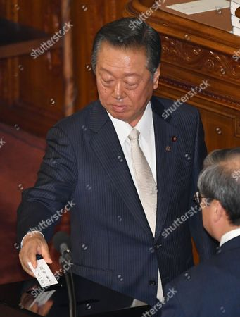 Ichiro Ozawa, leader of the opposition Liberal Party, casts his ballot in a parliamentary election to choose the nation's leader