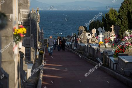 People visit the cementery of Ballena on the All Saints Day in Castro Urdiales, Cantabria, Spain, 01 November 2017. All Saints' Day is a Christian festival mainly celebrated by Catholics to remember the dead. People visits the graves of loved ones and place candles and flowers.