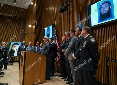 With photos displayed of Sayfullo Saipov, who is accused of driving a truck during an attack on a bike path that killed eight and injured several others, Deputy Commissioner of Intelligence & Counter-terrorism John Miller speaks during a news conference at One Police Plaza, in New York