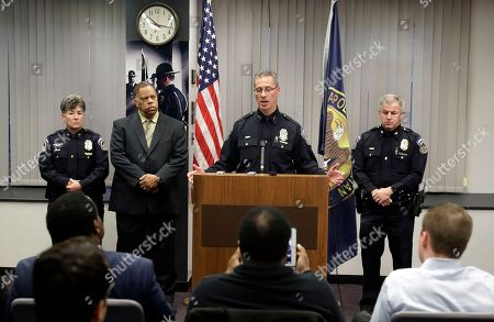 Indianapolis Metropolitan Police Department Chief Bryan Roach speaks during a news conference, in Indianapolis. The chief said the department's firearms review board will meet Friday to begin assessing whether the officers followed department policies in the death of 45-year-old Aaron Bailey. A special prosecutor announced Tuesday that the officers won't face criminal charges in the shooting