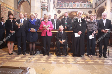 (L-R) State Premier of Saxony-Anhalt Reiner Haseloff, Minister of State for Culture Monika Gruetters, German Chancellor Angela Merkel, Bundestag President Wolfgang Schaeuble, Regional Bishop and Chairman of the Council of the Evangelical Church Germany Heinrich Bedford-Strohm, wife Elke Buedenbender and German President Frank-Walter Steinmeier attend a holy mass in Castle Church